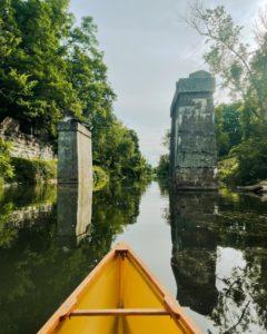 canoe approaching bridge supports