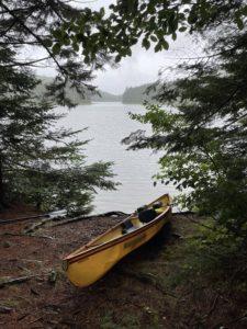 Hornbeck canoe on the shore of G Lake